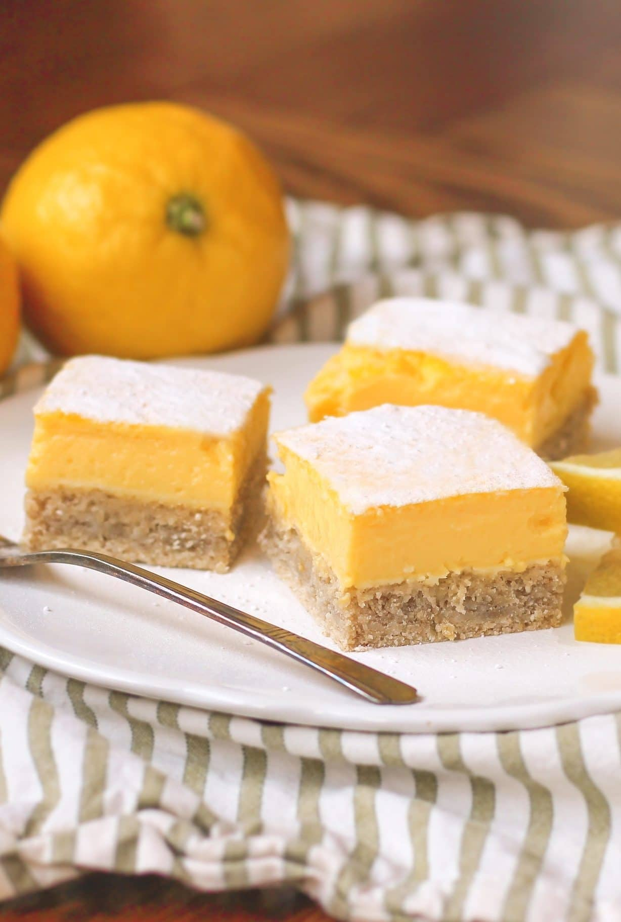 These Healthy Lemon Bars are made with stevia instead of refined sugar. They are sugar free, high in fiber and protein, gluten free, and taste delicious! Recipe in the Naughty or Nice Cookbook: The ULTIMATE Healthy Dessert Cookbook