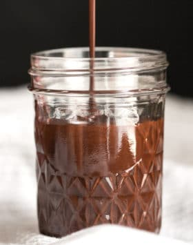 Healthy Homemade Chocolate Syrup recipe -- thick, rich, sweet, and chocolatey, yet secretly sugar free, low fat, high fiber, gluten free, and vegan! Perfect in chocolate milk, milkshakes, smoothies, oatmeal, and more. Healthy Dessert Recipes at Desserts with Benefits