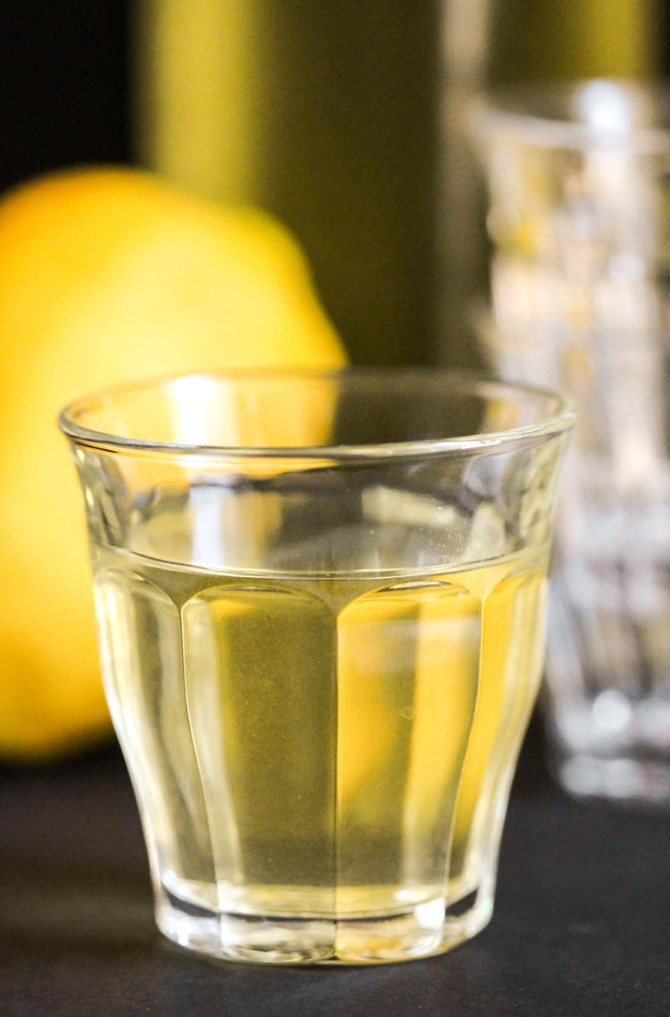 This Healthier Homemade Limoncello recipe is all natural (no artificial food coloring added), low calorie, refined sugar free, gluten free, and vegan, but you'd never know it! Healthy Dessert Recipes at Desserts with Benefits