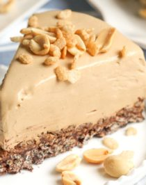 This Healthy Peanut Butter Chocolate Crunch Pie has got a thick, rich, and delicious peanut butter filling atop a crunchy, chocolatey base. And it's all no-bake, low sugar, high protein, high fiber, gluten free, dairy free, and vegan. This healthy dessert recipe is magic in a slice! Healthy Dessert Recipes at Desserts with Benefits