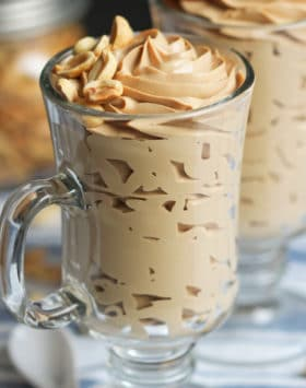 This rich and decadent Healthy Peanut Butter Mousse recipe is secretly guilt free, sugar free, low carb, high protein, gluten free, dairy free, AND vegan! -- Healthy Dessert Recipes at Desserts with Benefits