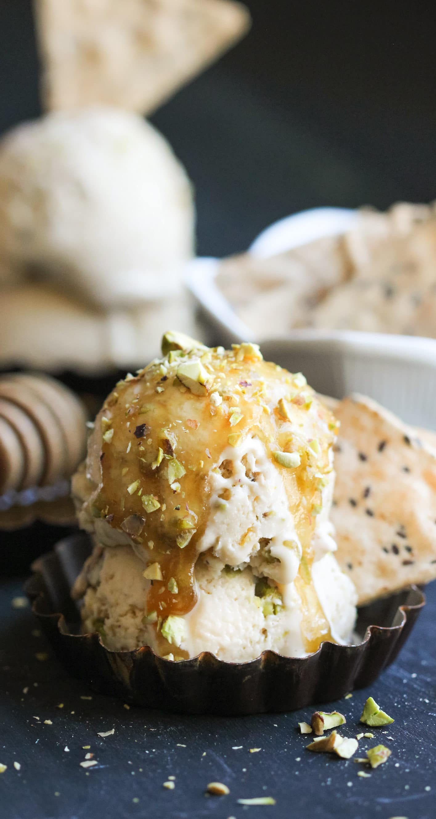 This deliciously sweet and creamy Healthy Baklava Ice Cream is laced with raw honey and studded with chopped pistachios and a crunchier, crispier, and more nutritious gluten-free substitute to phyllo dough. It seriously tastes like baklava swirled into ice cream! You'd never know it's refined sugar free, gluten free, and high protein! -- Healthy Dessert Recipes with sugar free, low calorie, low fat, high protein, gluten free, dairy free, and vegan options at the Desserts With Benefits Blog (www.DessertsWithBenefits.com)
