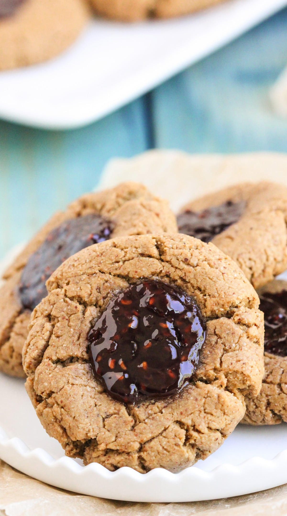 These soft and chewy 7-ingredient Healthy Thumbprint Cookies are so simple and delicious, you'd never know they're refined sugar free, gluten free, dairy free, and vegan! Healthy Dessert Recipes with low calorie, low fat, high protein, high fiber, and raw options at the Desserts With Benefits Blog (www.DessertsWithBenefits.com)