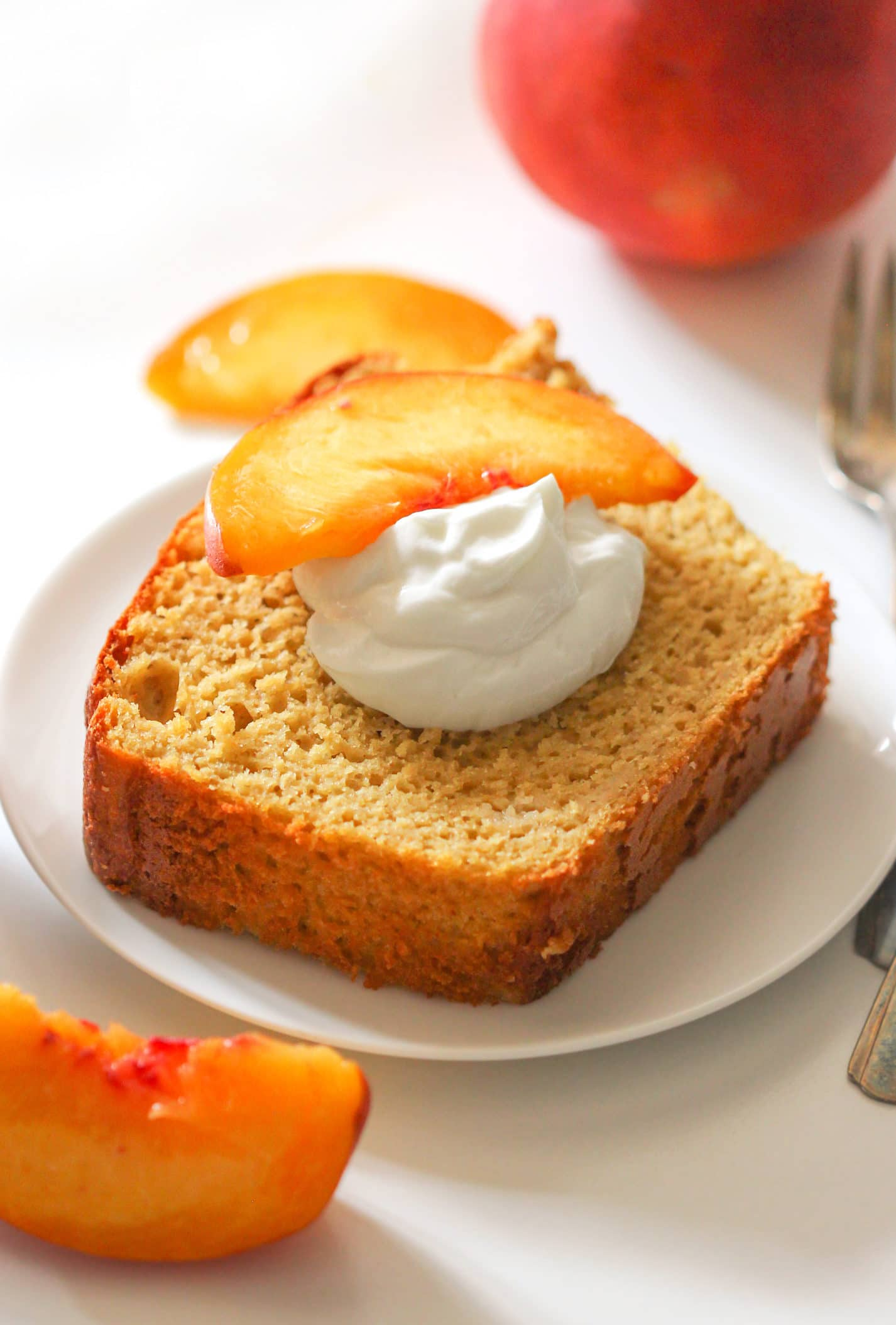 Healthy Nectarine Olive Oil Pound Cake! Yes, olive oil in a dessert, and it works! This light cake is perfectly sweet and 100% satisfying. Made with whole wheat flour, yogurt, and organic extra virgin olive oil, and none of the butter or sugar… but you'd never know it! Healthy Dessert Recipes with sugar free, low calorie, low fat, low carb, high protein, gluten free, dairy free, vegan, and raw options at the Desserts With Benefits Blog (www.DessertsWithBenefits.com)