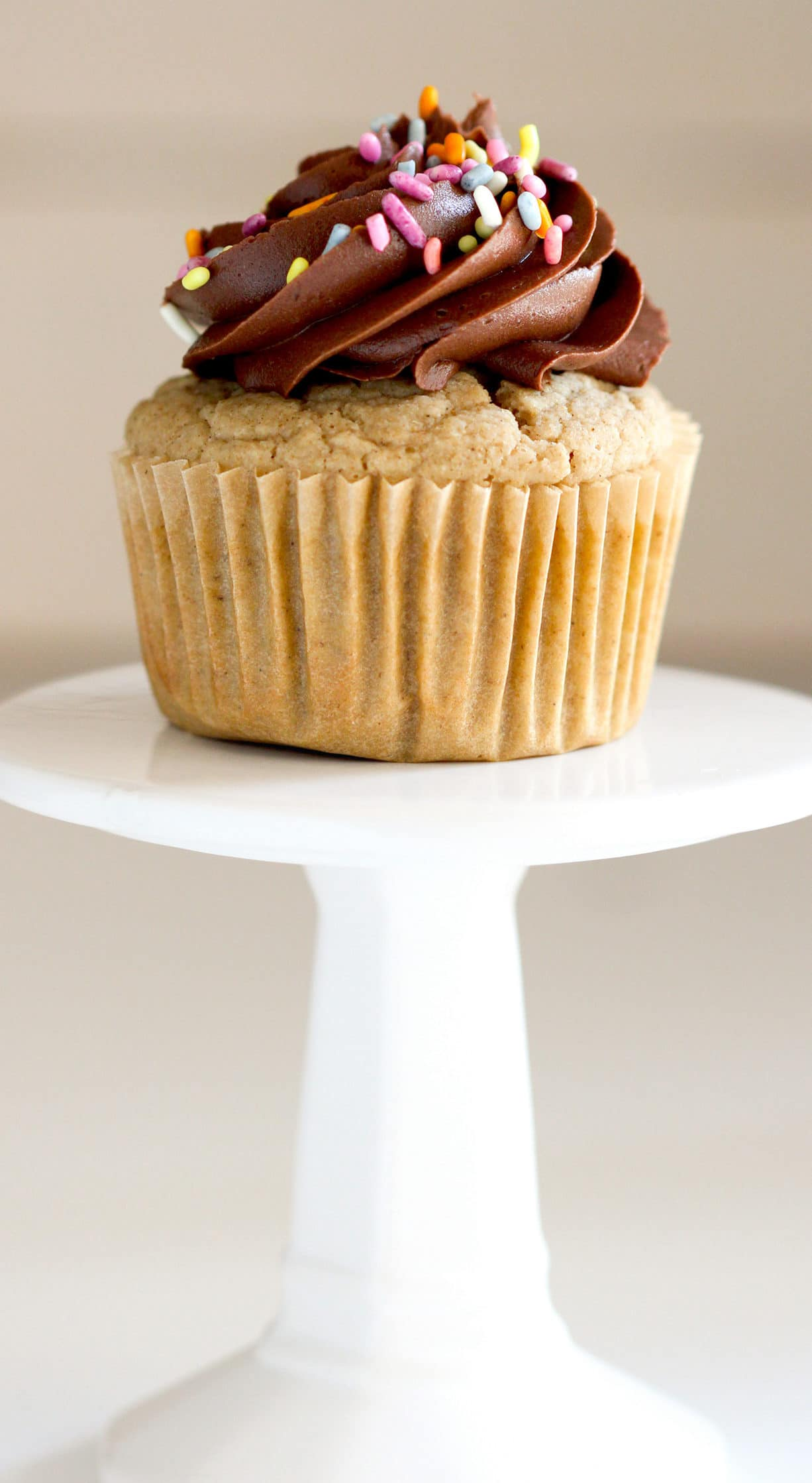 These Healthy Gluten-Free Vanilla Cupcakes will restore your faith in gluten-free baked goods! They're soft, fluffy, moist, and sweet with comforting tones of vanilla bean in every bite. You'd never know these are sugar free, low fat, gluten free, and just 90 calories per cupcake! Healthy Dessert Recipes with sugar free, low calorie, low fat, low carb, high protein, gluten free, dairy free, vegan, and raw options at the Desserts With Benefits Blog (www.DessertsWithBenefits.com)