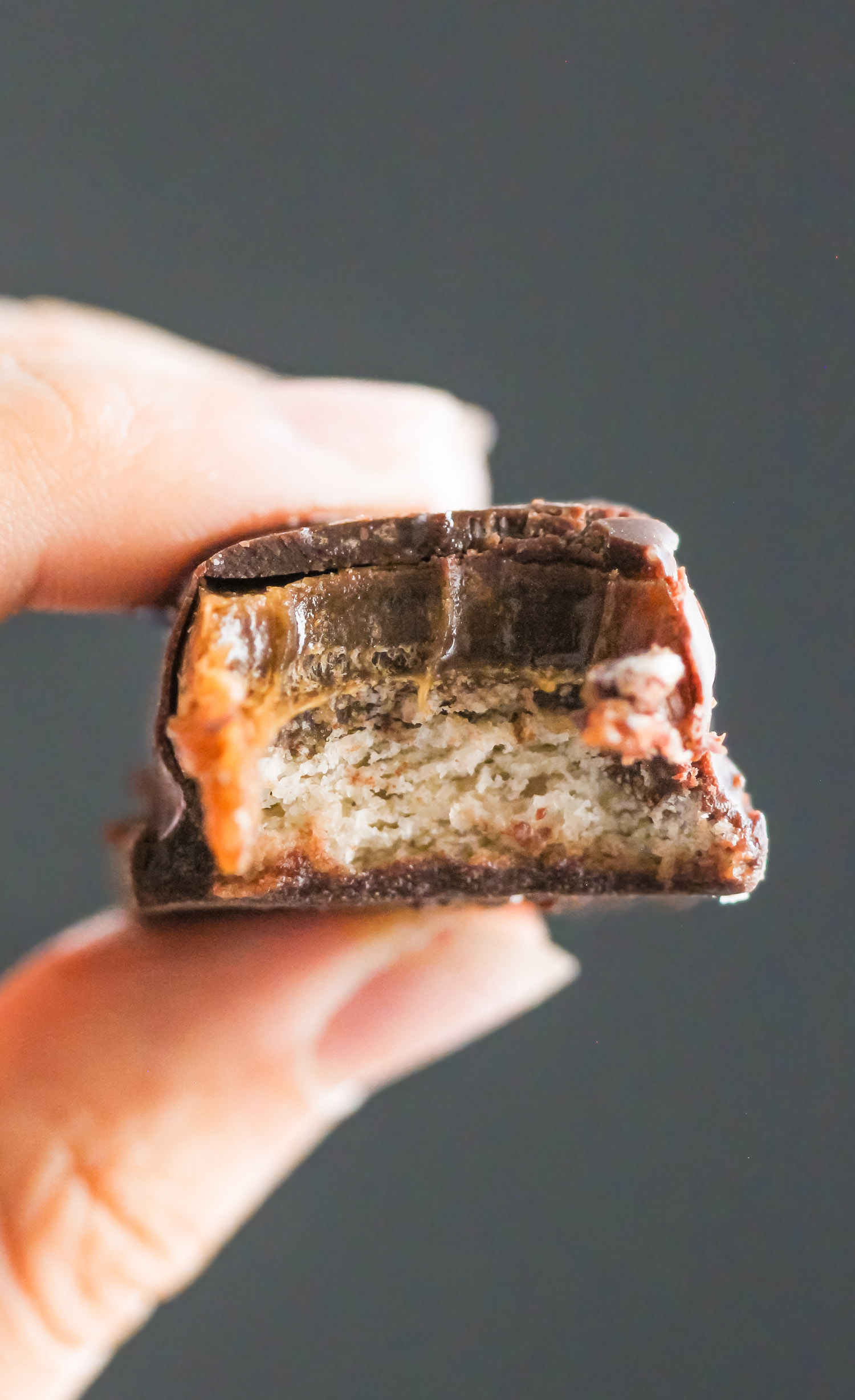 These guilt free homemade Twix candy bars are LIFE CHANGING. They taste just like the storebought kind, except these are all natural, vegan, dairy free, and reduced sugar. One bite and you'll think you're eating something full of sugar, fat, and calories, but you're not! Healthy Dessert Recipes with sugar free, low calorie, low fat, high protein, and gluten free options at the Desserts With Benefits Blog (www.DessertsWithBenefits.com)
