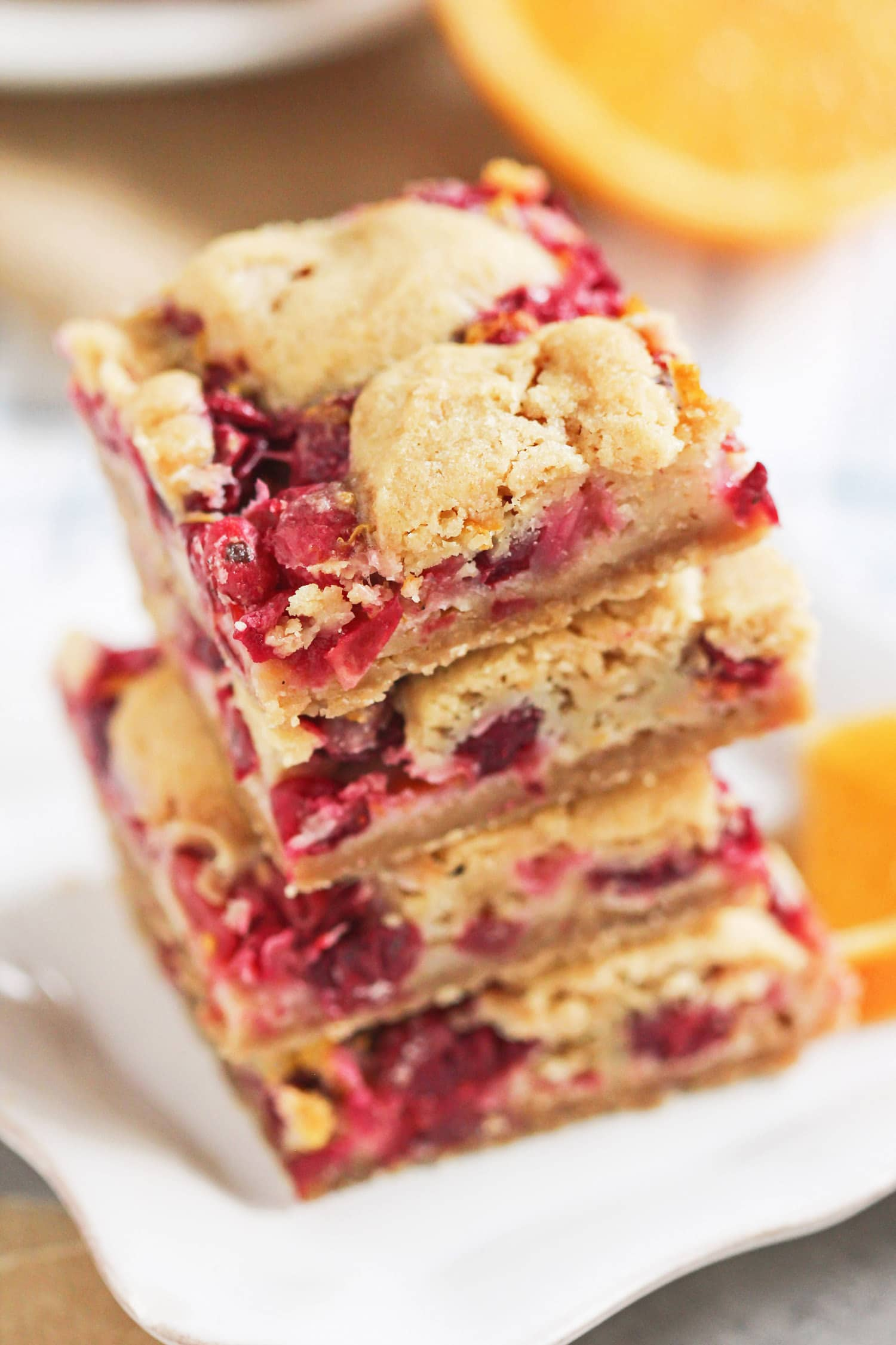 Guilt Free Cranberry Orange Bars – where blondies meet pie. These are seriously like a mix between sugar cookie blondies, a slice of cranberry pie, and the cranberry bliss bars at Starbucks. The perfect treat for the holidays. The kicker? They're low calorie, reduced fat, and lower sugar than your typical holiday desserts. Healthy Dessert Recipes at the Desserts With Benefits Blog (www.DessertsWithBenefits.com)