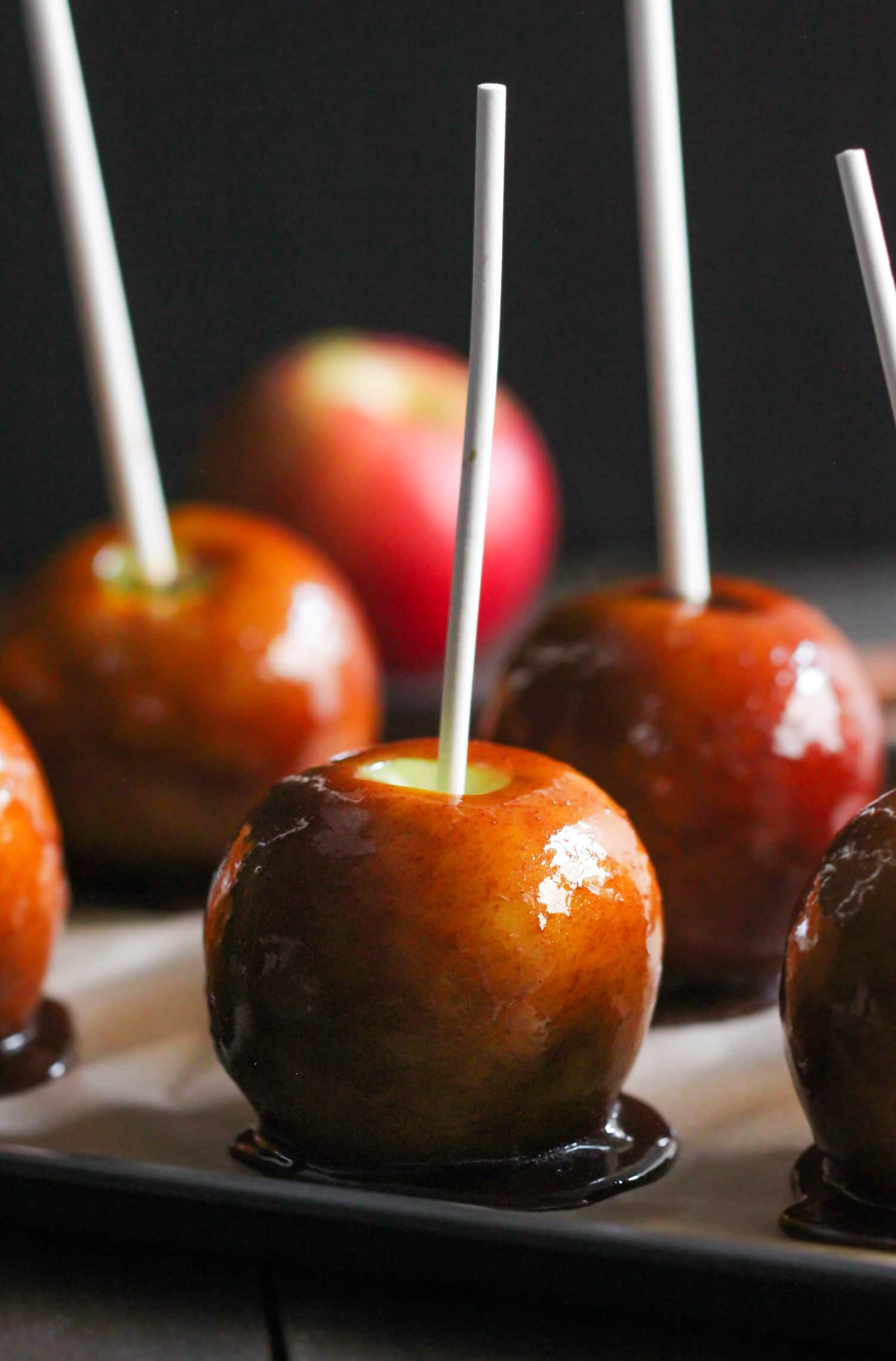 Healthy Caramel Apples! Love Caramel Apples but don't want all the sugar, corn syrup, cream, or butter? Make them at home! These sweet, crunchy apples are coated in a rich, sticky caramel. They're so addicting you'd NEVER suspect they're refined sugar free (made without corn syrup!), dairy free, and vegan. Healthy Dessert Recipes at the Desserts With Benefits Blog (www.DessertsWithBenefits.com)
