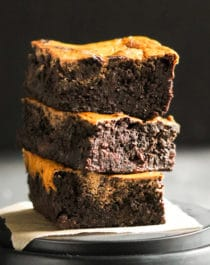 These Healthy Pumpkin Swirl Brownies are comprised of an UBER fudgy brownie base studded with chocolate chips, and are topped with a rich, cinnamon-spiced, pumpkin cream cheese swirl. These brownies are delicious, addictive, and secretly good for you too. You'd never guess these are sugar free, high protein, high fiber, and gluten free! Healthy Dessert Recipes at the Desserts With Benefits Blog (www.DessertsWithBenefits.com)