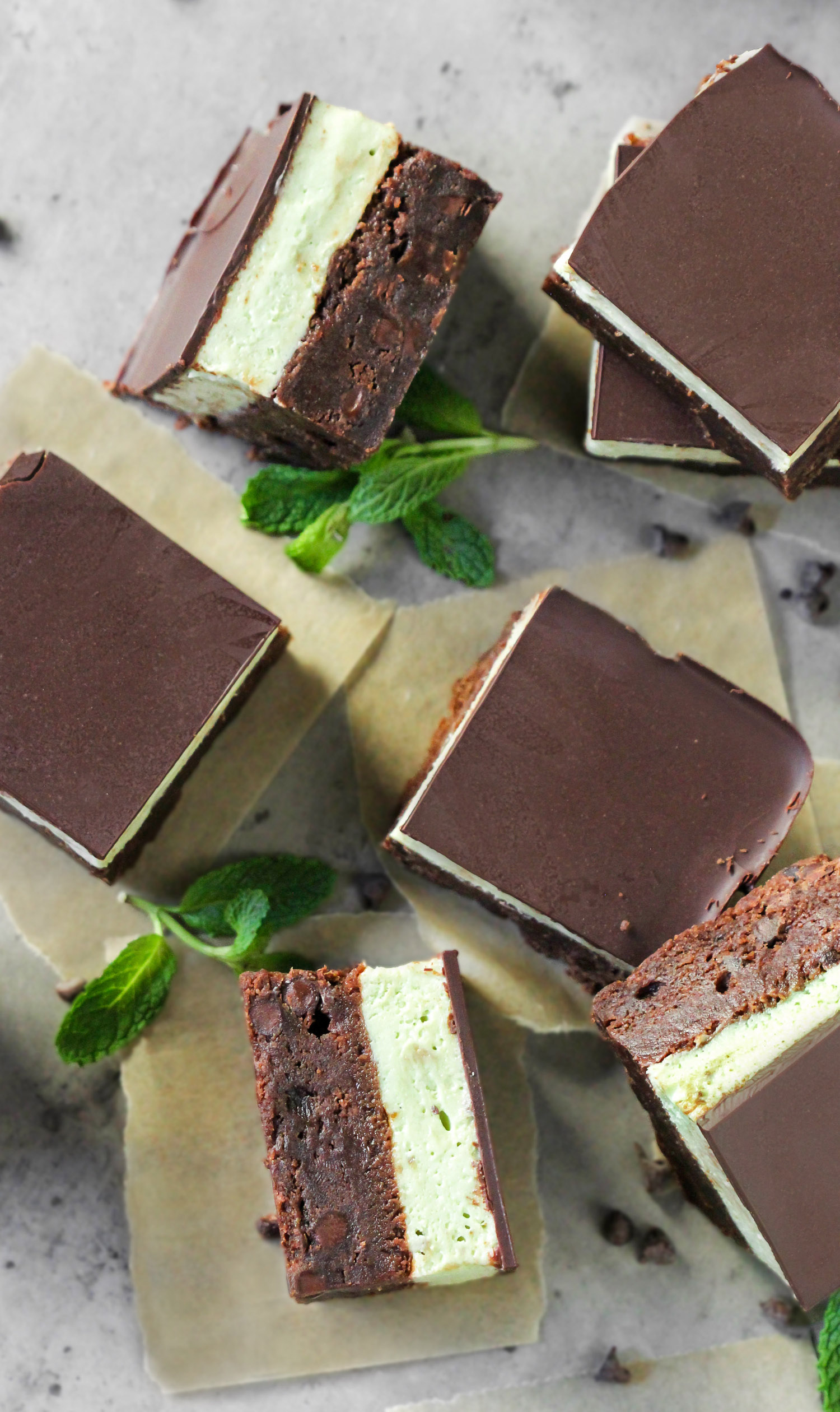 These Grasshopper Brownies are chocolatey, minty, sweet, and SUPREMELY delicious! Made with the fudgiest of the fudgy brownie base, a thick layer of mint frosting, and the perfect amount of dark chocolate to top everything off. This is one incredible, if not mind-blowing, dessert! Healthy Dessert Recipes at the Desserts With Benefits Blog (www.DessertsWithBenefits.com)
