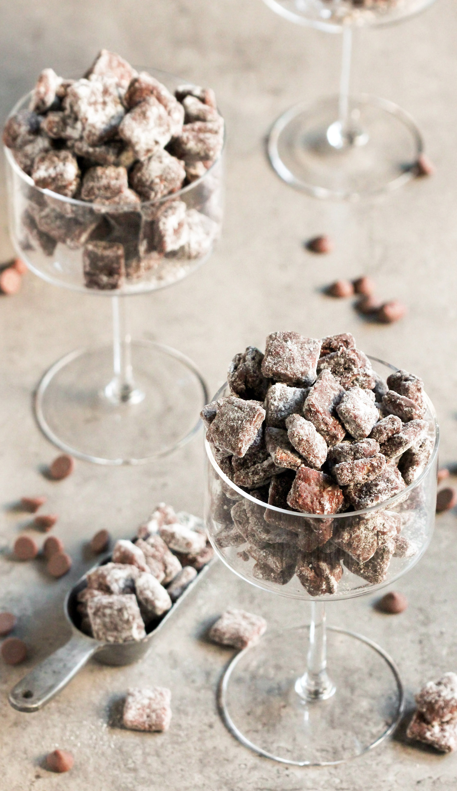These Healthy Muddy Buddies (or Healthy Puppy Chow, whatever you like to call it!) are the PERFECT snack! Crunchy, sweet, chocolatey, peanut buttery, and delicious. You'd never know it's got half the calories and fat as the original, a fraction of the sugar, and is dairy free and vegan too! Healthy Dessert Recipes at the Desserts With Benefits Blog (www.DessertsWithBenefits.com)
