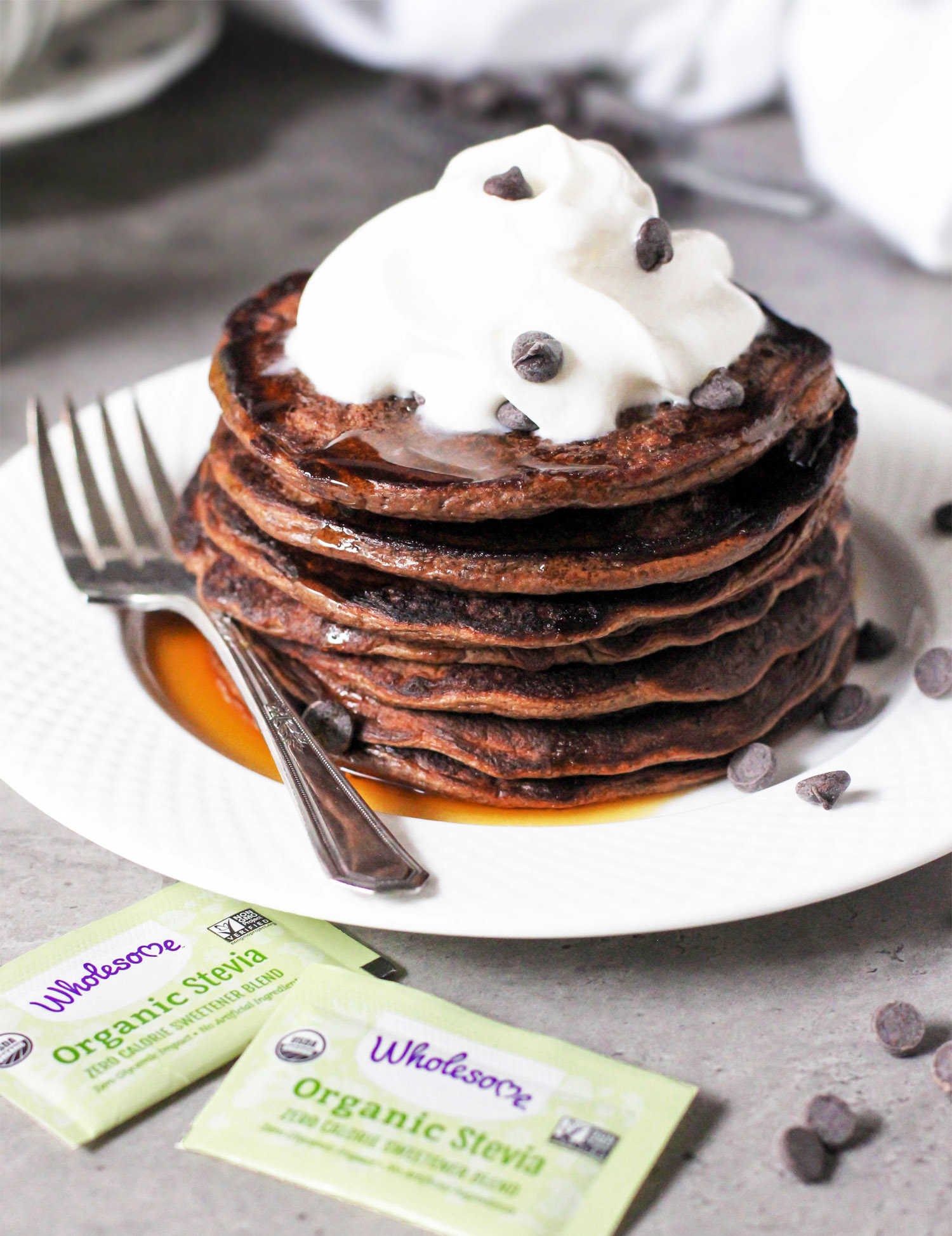 These Healthy Chocolate Protein Pancakes are uber light and fluffy, and they're perfectly sweet and chocolatey too. One bite and you won't be able to tell they're gluten free, sugar free, low fat, and packed with a whopping 18g of protein per serving!