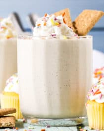 This Cake Batter Dip looks and tastes like you tossed a slice of Vanilla Cake into a blender, frosting and all!  It's ultra buttery and sweet, rich and flavorful, and smooth and creamy.  One bite and you'd never guess it's healthy, sugar free, low fat, high protein, and gluten free too.  Serve up this deliciousness alongside some Graham Crackers, Animal Crackers, fresh strawberries, or spoons alone.