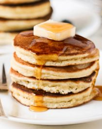 These fluffy Low Carb Coconut Flour Pancakes are THE best way to start your day. One bite and you'll wonder how these Paleo Pancakes are sugar free, low carb, high protein, high fiber, gluten free, and dairy free! These filling Low Carb Pancakes have just 220 calories plus 15g of protein and no sugar added. This is a breakfast we can feel good about indulging in.