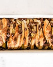 Chunky Monkey Pull Apart Bread -- a sweet loaf made of layers of dough, filled with bananas, rich peanut butter, and decadent chocolate chips. This 5-ingredient recipe is dairy free, vegan, and doesn't have any added sugar... but you'd never know it!