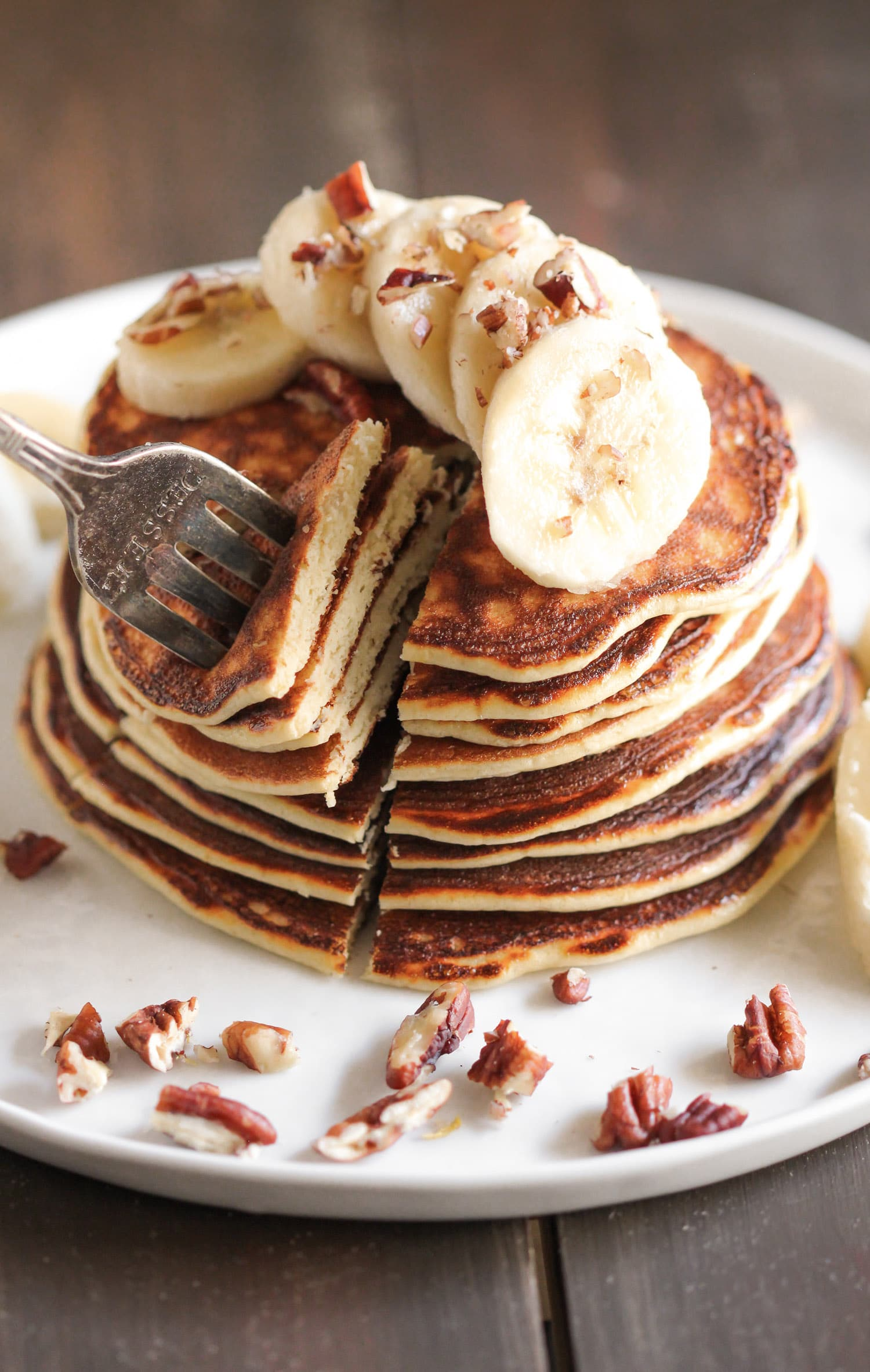 These Healthy Banana Protein Pancakes are uber light and fluffy, and they're perfectly sweet too. One bite and you won't be able to tell they're gluten free, refined sugar free, low fat, and packed with a whopping 22g of protein per serving! Healthy Dessert Recipes at the Desserts With Benefits Blog (www.DessertsWithBenefits.com)