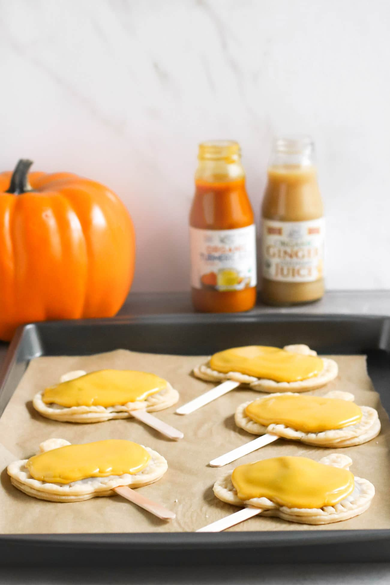 Pumpkin Pie Pops -- where Pumpkin Pie meets limited edition Pumpkin Pie Pop Tarts meets secretly good-for-you deliciousness! They're rich and sweet to satisfy your sweet tooth, and they're secretly vegan, dairy free, and low sugar too! What can be better than homemade pumpkin pie filling all wrapped up in a flavorful pie crust? Everything about these screams Fall, Halloween, cool weather, fuzzy sweaters, and good feels. These are a guaranteed crowdpleaser, and definitely a dessert to impress!