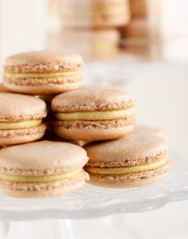 These Pumpkin Spice French Macarons are naturally orange and perfectly sweet and spicy, thanks to the cinnamon, ginger, nutmeg, and cloves! Unlike most macarons, which are made with bleached sugar and artificial flavors, these are all natural and gluten free! #pumpkinpiespice #frenchmacarons #macarons #glutenfree #glutenfreemacarons #healthier