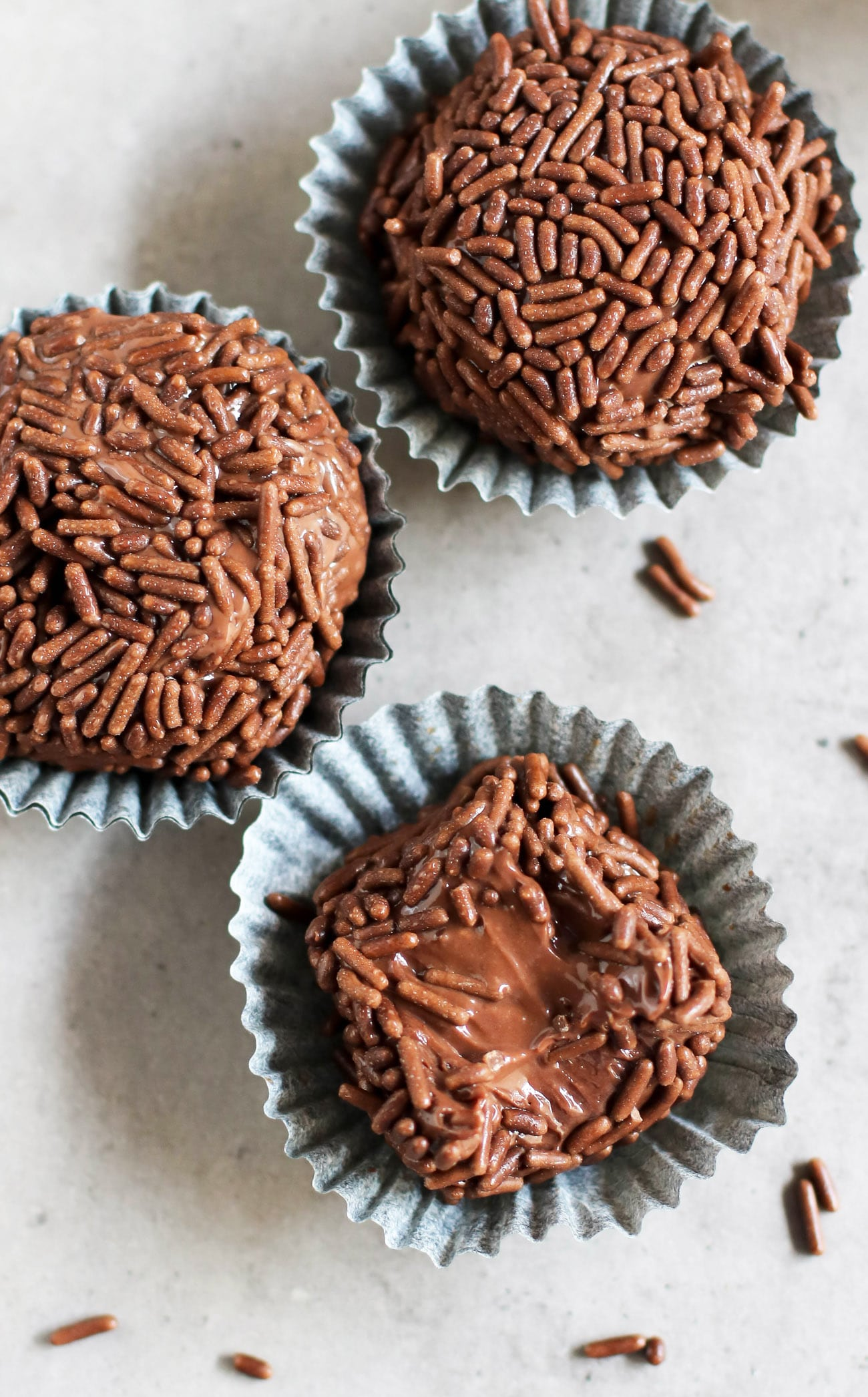 These Healthy Brigadeiros are ULTRA fudgy, smooth, and creamy, with a slight crunch from the chocolate sprinkles. The taste is SPOT ON! You'd never guess that these Brazilian chocolate truffles are made with healthier ingredient swaps to make them lower in calories, fat, and sugar compared to the original.