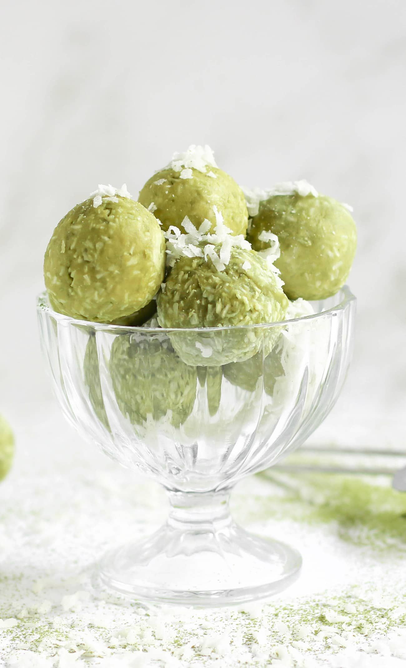 Easy, no-bake, 6-ingredient Matcha Coconut Truffles made healthy! They're rich and sweet yet made without butter, heavy cream, and sugar. They're keto-friendly, low carb, sugar free, and gluten free too!