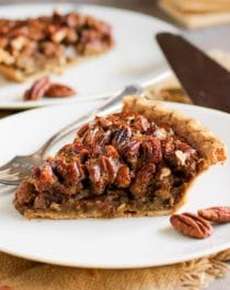 This Healthy Pecan Pie is so rich and decadent, every bite is pure joy -- you'd never know it's made without the corn syrup, white sugar, butter, and heavy cream! This freezer friendly Pecan Pie is an all natural, good-for-you dessert that is perfect for Thanksgiving, Christmas, birthdays, or any day for that matter!