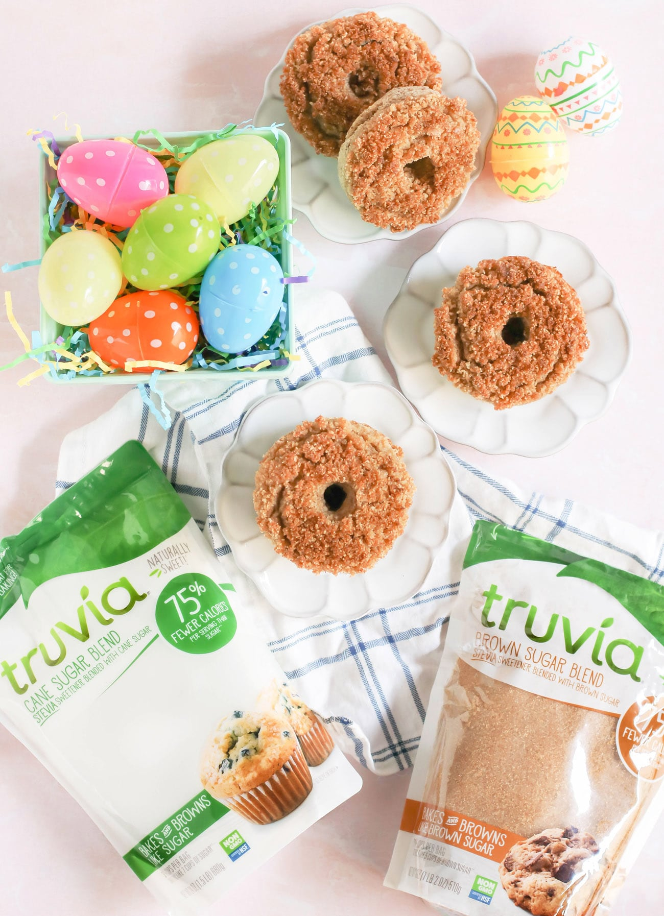 These easy BakedCrumb Donuts are rich, sweet, full of vanilla flavor, and a coffee cake-like crumb topping. Every bite is buttery and satisfying. You'd never know these donuts are gluten free, high in protein and fiber, and made with less sugar than regular donuts, thanks to using the Truvia Cane Sugar Blend and Truvia Brown Sugar Blend!