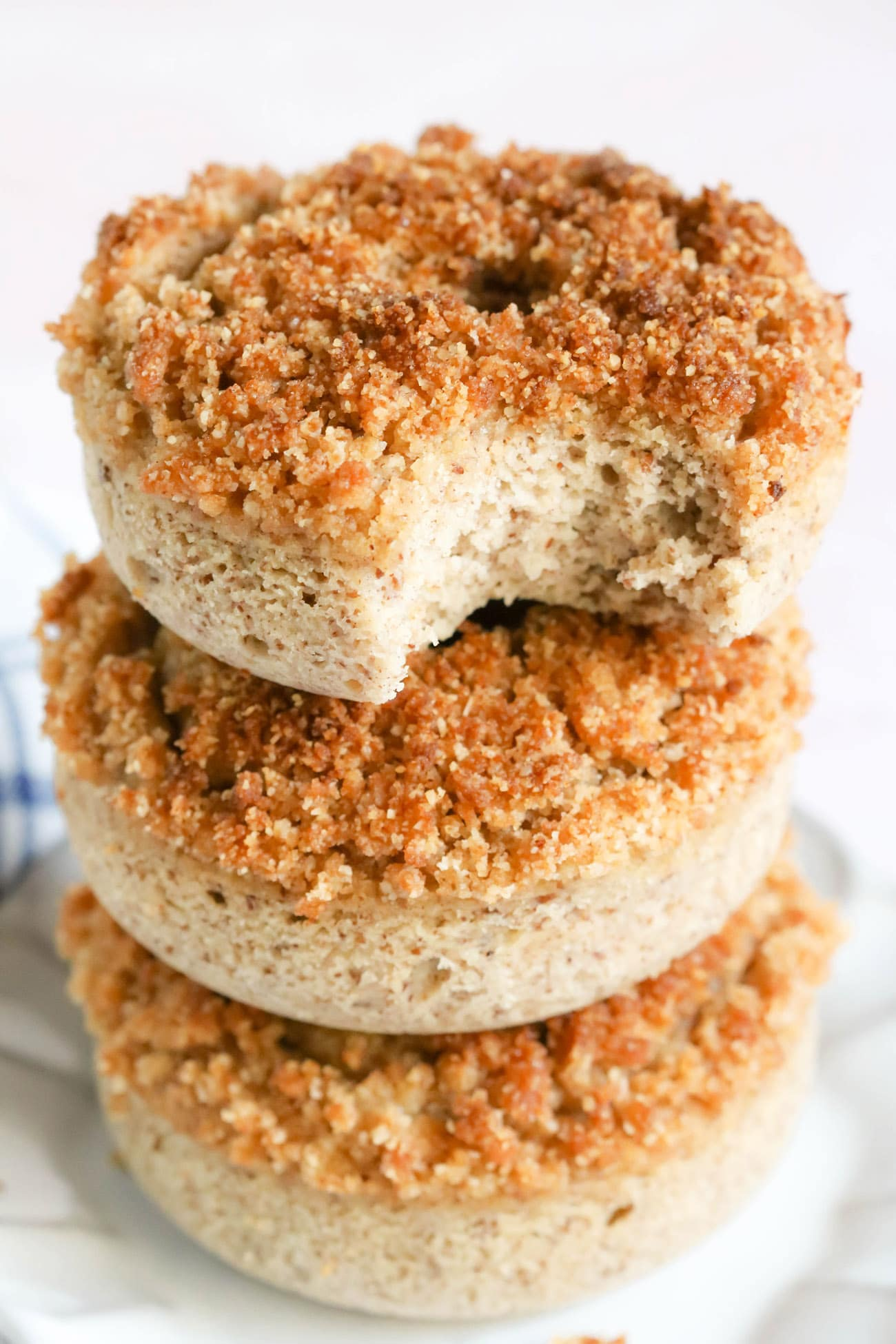 These easy BakedCrumb Donuts are rich, sweet, full of vanilla flavor, and a coffee cake-like crumb topping. Every bite is buttery and satisfying. You'd never know these donuts are gluten free, high protein, high fiber, and low sugar!